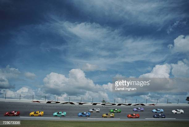 Pontiac Firebird Trans Am race cars on the banking between turns 3 and four during the IROC XXI International Race of Champions on 14 February 1997...
