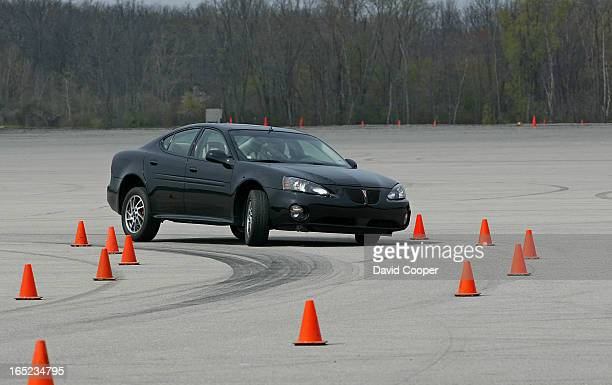 Pontiac Grand Prix GTP during timed Slalom at the GM testing facility in Michigan Bob Lutz vs Jim Kenzie May 3 2003