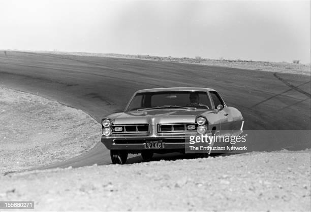 Pontiac Grand Prix rounding a corner during track testing