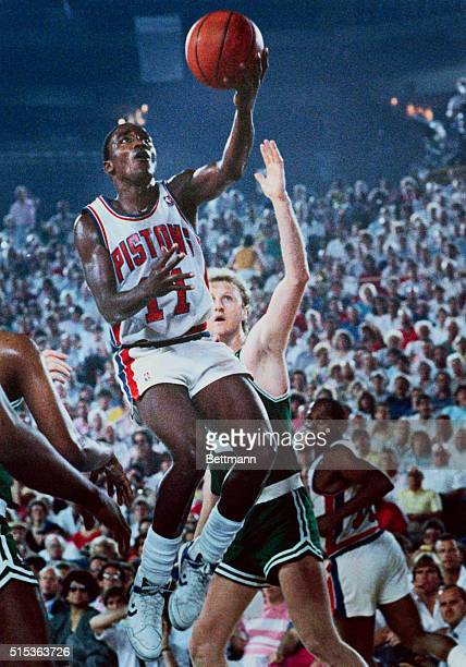Pontiac, Mich.: Detroit Pistons' Isiah Thomas looks more like a bird than Larry Bird of the Boston Celtics during the third quarter of their game....