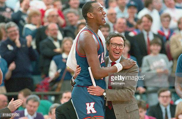 Kansas Coach Larry Brown hugs Danny Menning after Kansas defeated Kansas State 7158 to advance to the Final Four Manning was named Most Outstanding...