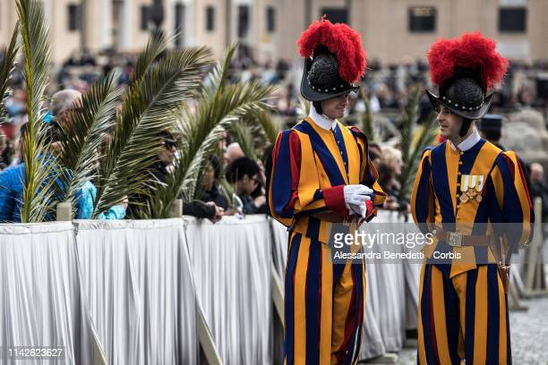 Pontifical Swiss Guards prepare for the Palm Sunday procession and Mass lead by Pope Francis in St Peter's Square on April 14 2019 in Vatican City...