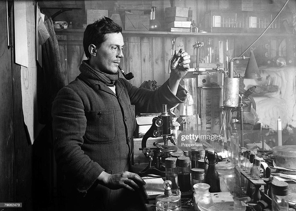 H.G Ponting. Captain Scott+s Antarctic Expedition 1910 - 1912. 15th September, 1911. Dr. Atkinson using scientific equipment as he performs experiments in his laboratory : News Photo