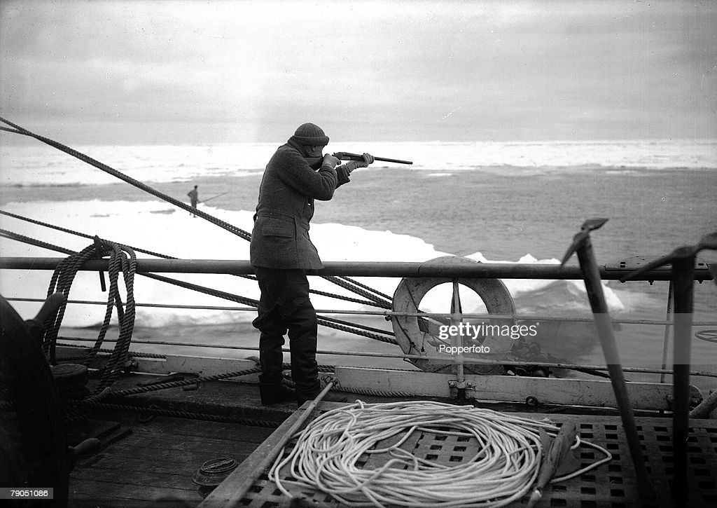 "H.G Ponting. Captain Scott+s Antarctic Expedition 1910 - 1912. 17th December, 1910. Dr. Wilson aims his rifle while practicing shooting on the deck of the ""Terra Nova"" ship. : News Photo"