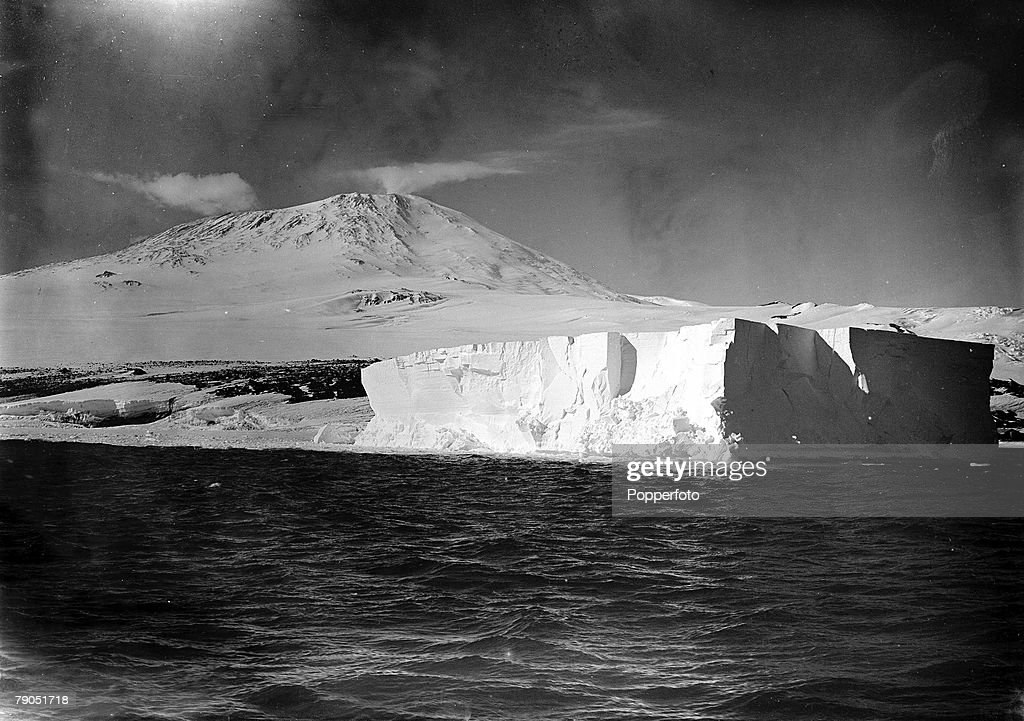 "H.G Ponting. Captain Scott+s Antarctic Expedition 1910 - 1912. 20th January, 1911. A picture of an iceberg sitting in front of Mount Erebus taken just after the ""Terra Nova"" ship struck. : News Photo"
