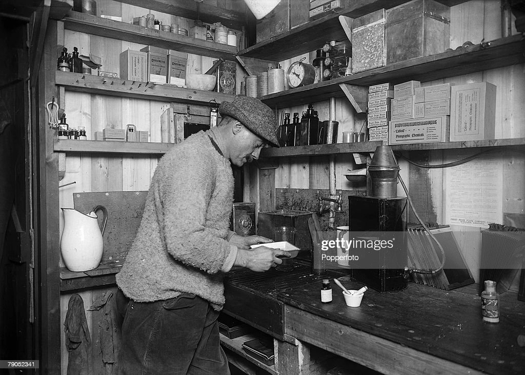H.G Ponting. Captain Scott+s Antarctic Expedition 1910 - 1912. 24th March, 1911. An interior view showing photographer Herbert Ponting at work in his darkroom. : News Photo