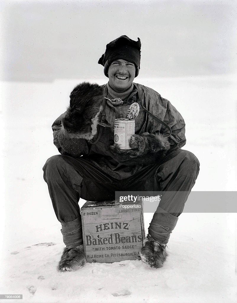 H,G Ponting, Captain Scott+s Antarctic Expedition 1910 - 1912, 9th January, 1912, An expedition team member enjoying his can of Heinz baked beans