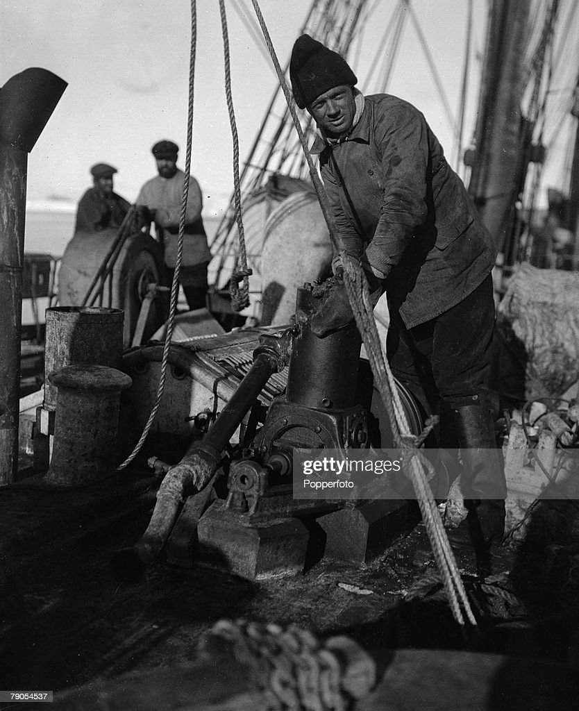 H.G Ponting. Captain Scott+s Antarctic Expedition 1910 - 1912. Expedition team member Williams at the sounding engine on board the Terra Nova ship. : News Photo