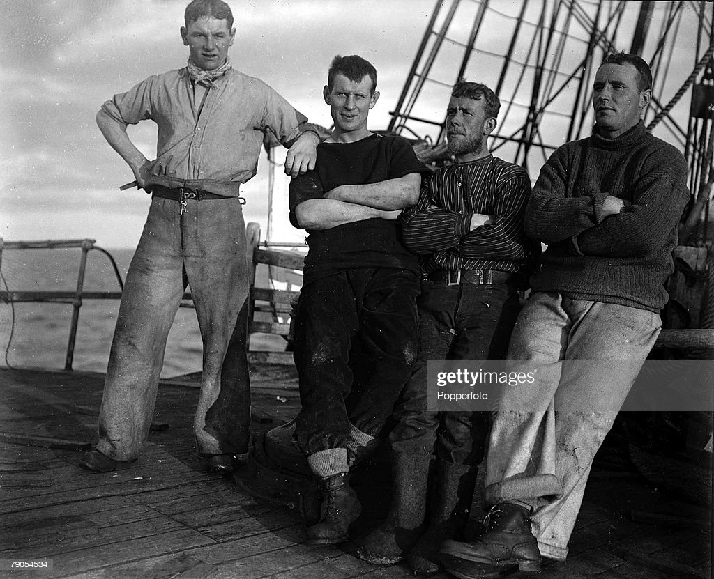 H.G Ponting. Captain Scott+s Antarctic Expedition 1910 - 1912. Full length portrait of crew members looking relaxed on the fo'castle on board the Terra Nova off the coast of New Zealand. : News Photo