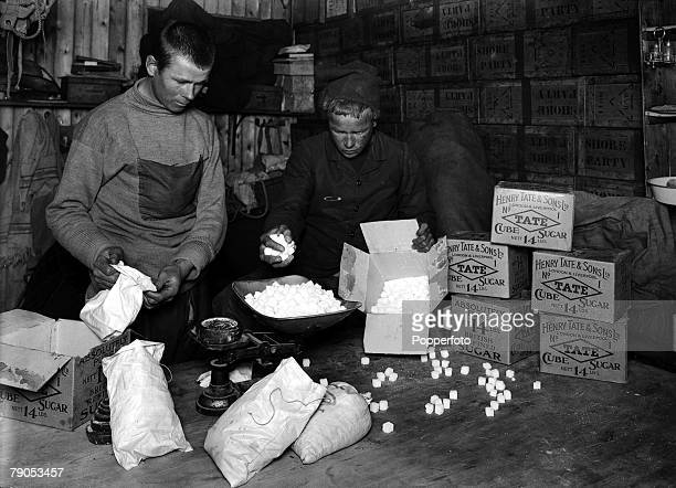 HG Ponting Captain Scotts Antarctic Expedition 1910 1912 January Expedition team members packing boxes of Tate sugar for sledging rations