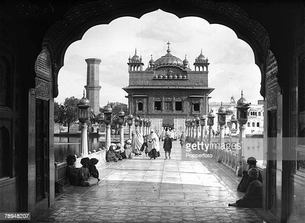 HG Ponting in Asia 1900 1906 Amritsar India A view through an archway showing the path leading up to the Golden Temple of Amritsar