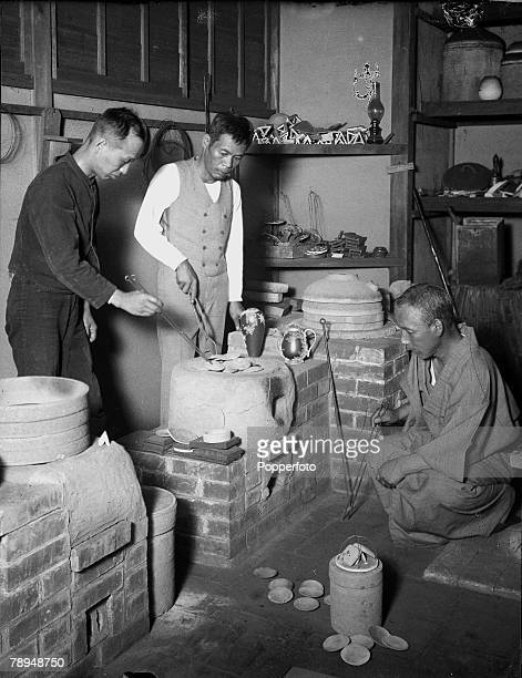 HG Ponting in Asia 1900 1906 Japan Japanese craftsmen firing cloisonne pottery ware in a kiln