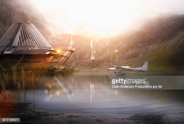 pontoon airplane on lake near futuristic house - premium access stock pictures, royalty-free photos & images