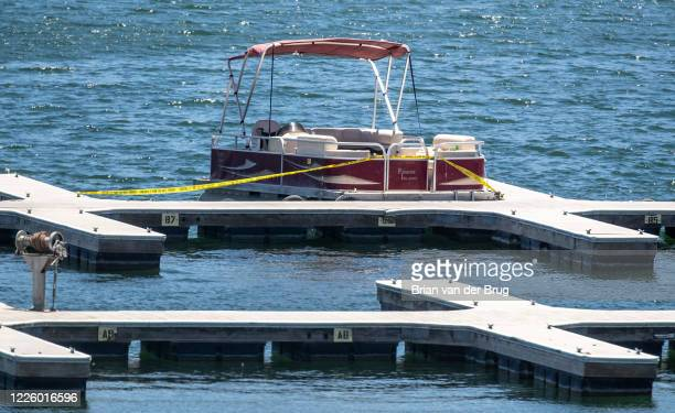 A pontoon boat at Lake Piru Marina rented by missing actress Naya Rivera is cordoned off with police tape Thursday July 9 2020 in Lake Piru CA