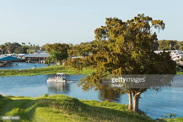 pontoon boat rides on lake okeechobee canal florida usa - lake okeechobee stock pictures, royalty-free photos & images