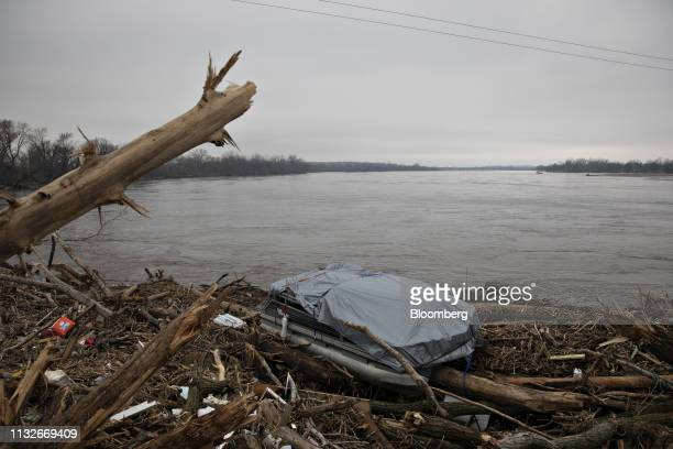 A pontoon boat sits atop debris lodged against a damaged Union Pacific Corp rail bridge over the Platte River in La Platte Nebraska US on Sunday...
