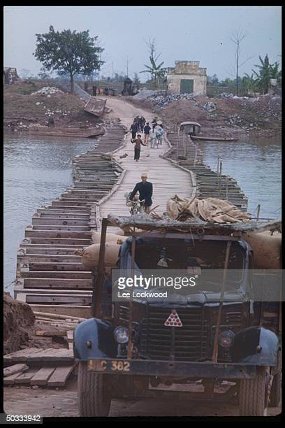 Pontoon bridge on outskirts of Nam Dinh enabling traffic to cross narrow river.