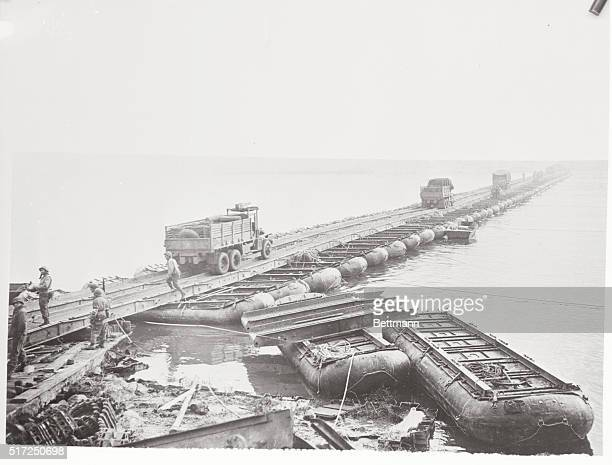 Pontoon Bridge Spans the Rhine. Germany: The work of Intrepid U.S Army engineers, this pontoon bridge spanning the Rhine River, carries trucks and...