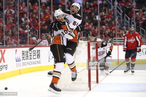 Pontus Aberg of the Anaheim Ducks celebrates his gamewinning goal with teammate Kiefer Sherwood against the Washington Capitals during the third...