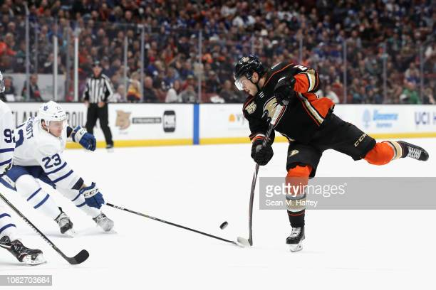 Pontus Aberg of the Anaheim Ducks shoots the puck as Travis Dermott of the Toronto Maple Leafs defends during the third period of a game at Honda...