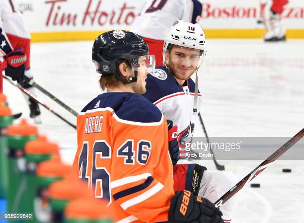 Pontus Aberg of the Edmonton Oilers exchanges words with Alexander Wennberg of the Columbus Blue Jackets on March 27 2018 at Rogers Place in Edmonton...