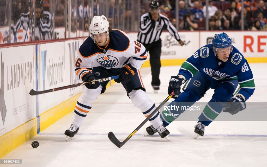 Pontus Aberg #46 of the Edmonton Oilers tries to break free from Jussi Jokinen #36 of the Vancouver Canucks in NHL action on March, 29, 2018 at Rogers Arena in Vancouver, British Columbia, Canada.