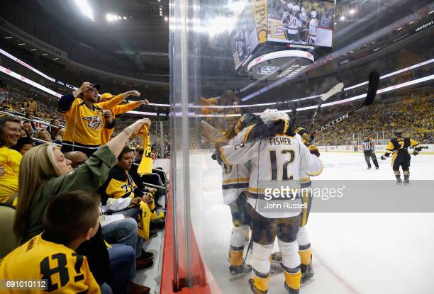 Pontus Aberg of the Nashville Predators celebrates his goal with teammates during the first period of Game Two of the 2017 NHL Stanley Cup Final...