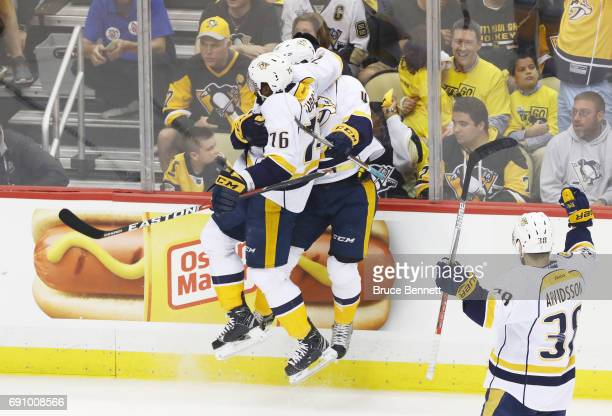 Pontus Aberg of the Nashville Predators celebrates with PK Subban after scoring a goal during the first period in Game Two of the 2017 NHL Stanley...