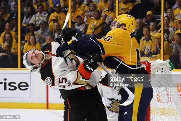 Pontus Aberg of the Nashville Predators hits Sami Vatanen of the Anaheim Ducks during the third period in Game Four of the Western Conference Final...