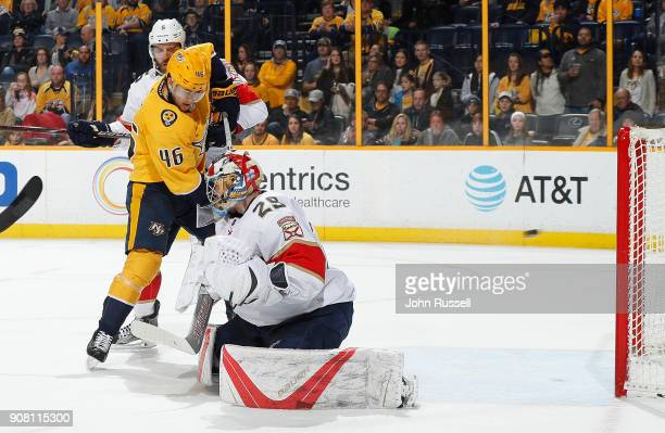 Pontus Aberg of the Nashville Predators screens goalie Harri Sateri of the Florida Panthers as a shot by PK Subban finds the net during an NHL game...
