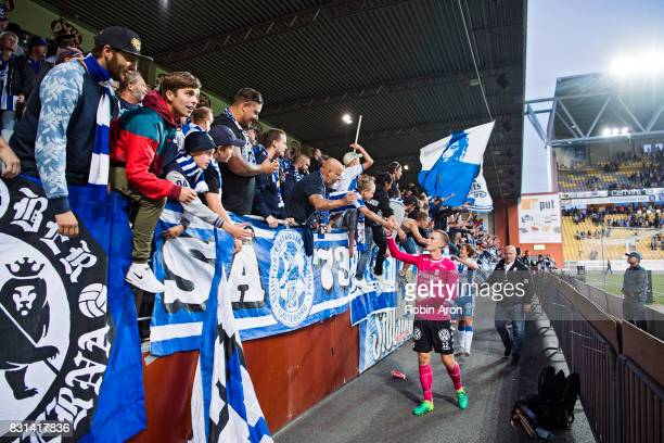 Pontus Dahlberg goalkeeper of IFK Goteborg and August Erlingmark celebrates after the victory with the fans after the Allsvenskan match between IF...