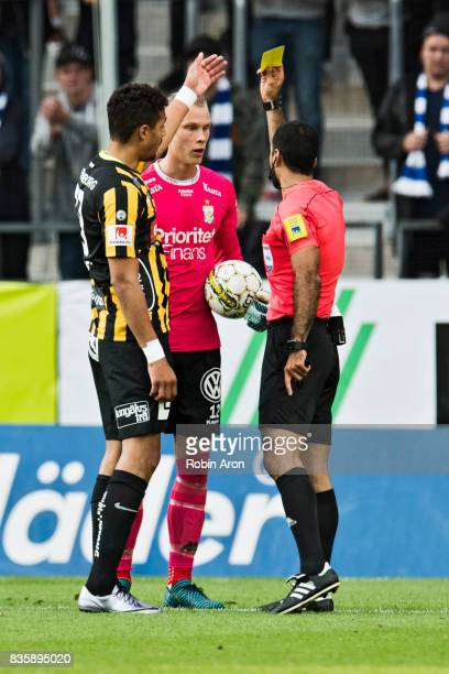 Pontus Dahlberg goalkeeper of IFK Goteborg receives a yellow card from referee Mohammed AlHakim during the Allsvenskan match between IFK Goteborg and...