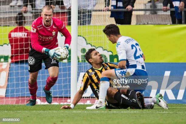 Pontus Dahlberg goalkeeper of IFK Goteborg upset and Mathias Ranegie of BK Hacken in under David Boo Wiklander of IFK Goteborg during the Allsvenskan...