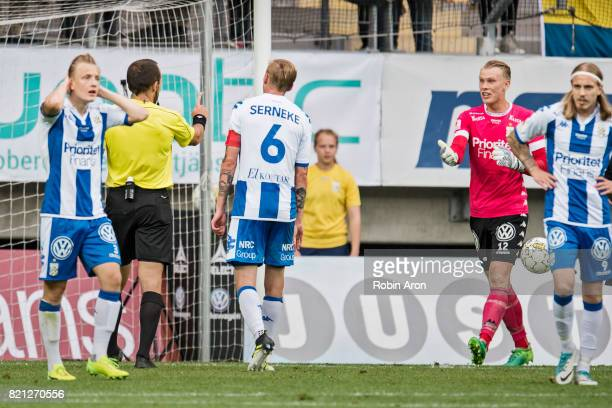 Pontus Dahlberg goalkeeper of IFK Goteborg upset on referee Kaspar Sjoberg who just judge penalty kick and dejected Scott Jamieson of IFK Goteborg...