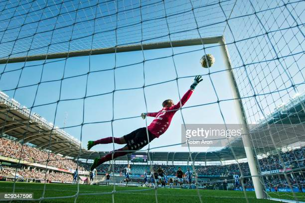 Pontus Dahlberg goalkeeper trying to stop the shot from Amin Affane of AIK who scores the opening goal 01 during the Allsvenskan match between IFK...