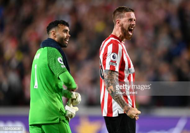 Pontus Jansson and David Raya of Brentford celebrate after the Premier League match between Brentford and Arsenal at Brentford Community Stadium on...