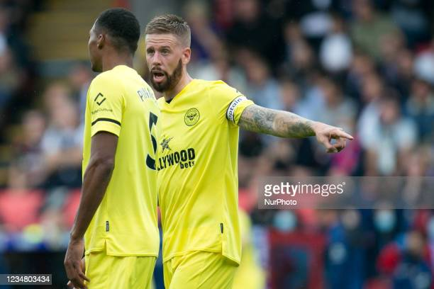Pontus Jansson of Brentford and Ethan Pinnock of Brentford looks on during the Premier League match between Crystal Palace and Brentford at Selhurst...