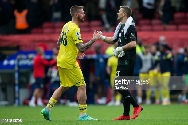 Pontus Jansson of Brentford and Jack Butland of Crystal Palace gestures during the Premier League match between Crystal Palace and Brentford at...