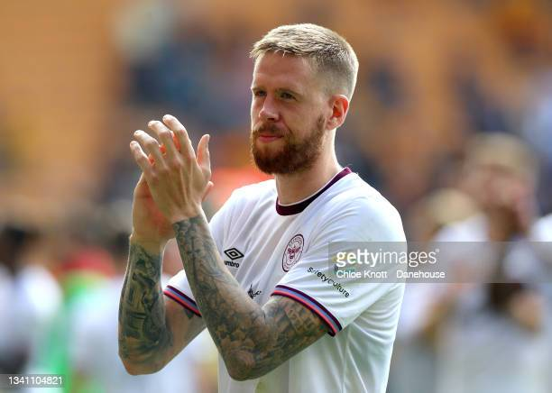 Pontus Jansson of Brentford applauds the fans after during the Premier League match between Wolverhampton Wanderers and Brentford at Molineux on...