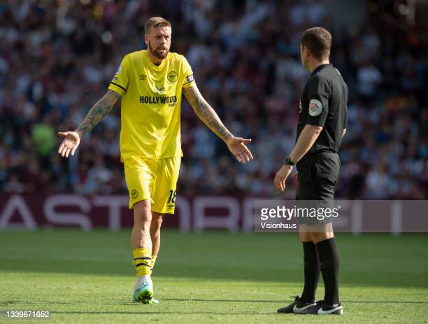 Pontus Jansson of Brentford complains to referee Peter Bankes during the Premier League match between Aston Villa and Brentford at Villa Park on...