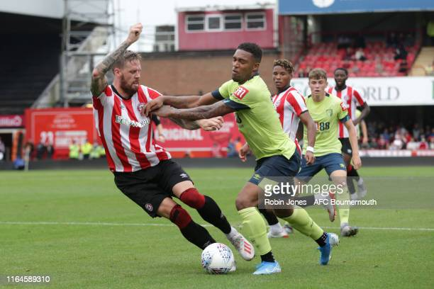 Pontus Jansson of Brentford FC and Jordon Ibe of Bournemouth during the Pre-Season Friendly match between Brentford and AFC Bournemouth at Griffin...