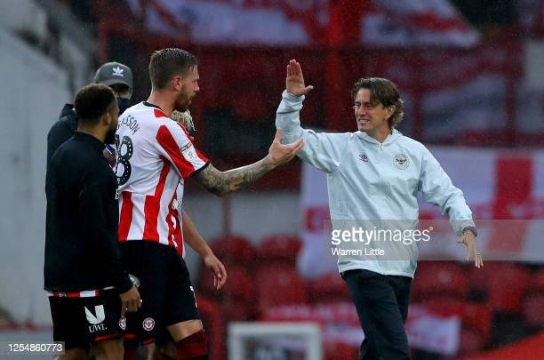 Pontus Jansson of Brentford is congratulated by Thomas Frank the manager of Brentford during the Sky Bet Championship match between Brentford and...