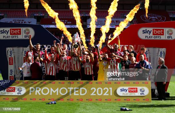 Pontus Jansson of Brentford lifts the Sky Bet Championship Play Off Trophy following victory in the Sky Bet Championship Play-off Final between...