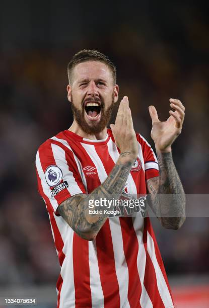 Pontus Jansson of Brentford salutes the fans after the Premier League match between Brentford and Arsenal at Brentford Community Stadium on August...