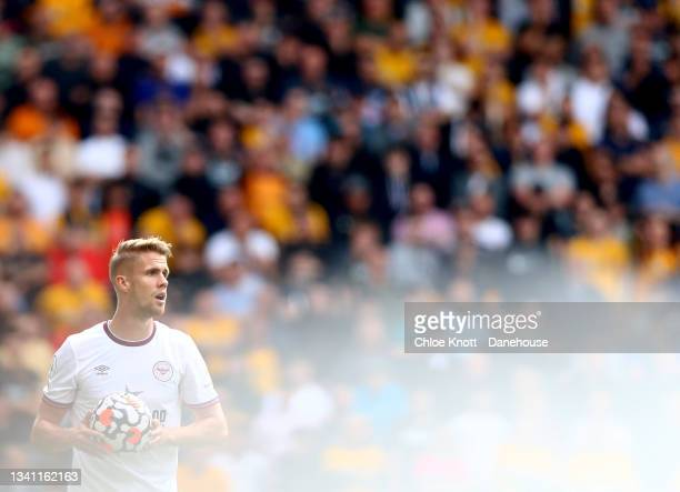 Pontus Jansson of Brentford takes a throw in during the Premier League match between Wolverhampton Wanderers and Brentford at Molineux on September...