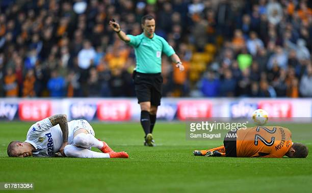 Pontus Jansson of Leeds United and Jon Dadi Bodvarsson of Wolverhampton Wanderers both injured during the Sky Bet Championship match between...