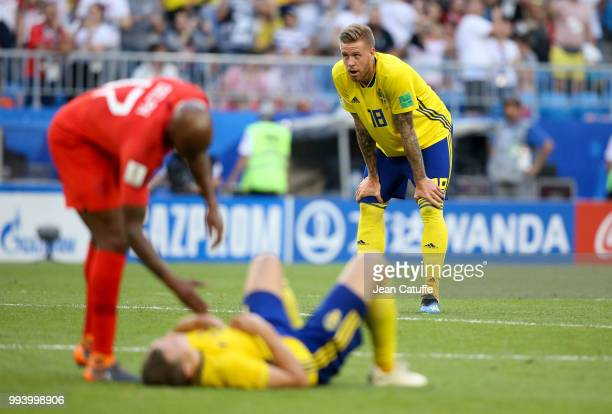 Pontus Jansson of Sweden looks on while Fabian Delph of England consoles Victor Lindelof of Sweden following the 2018 FIFA World Cup Russia Quarter...