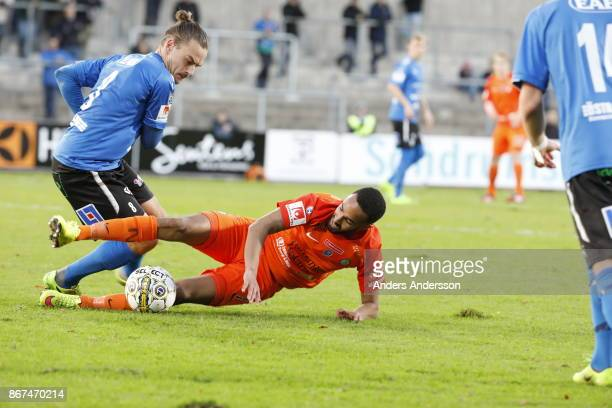 Pontus Silfwer of Halmstad BK and Ferid Ali of Athletic FC Eskilstuna compete for the ball during the Allsvenskan match between Halmstad BK and...