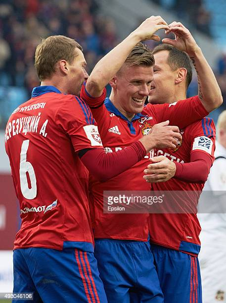 Pontus Wernbloom Aleksei Berezutski and Sergei Ignashevich of PFC CSKA Moscow celebrate a goal during the Russian Premier League match between PFC...