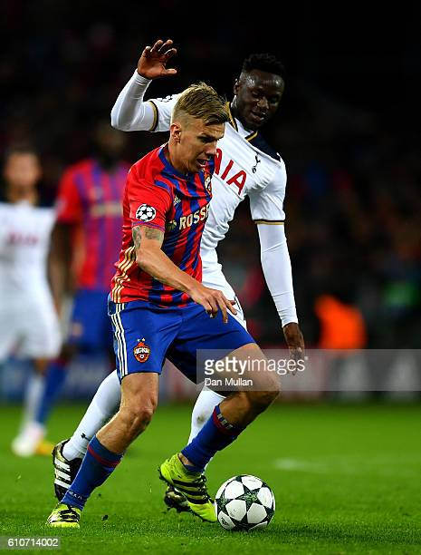 Pontus Wernbloom of CSKA Moscow holds off Victor Wanyama of Tottenham Hotspur during the UEFA Champions League Group E match between PFC CSKA Moskva...